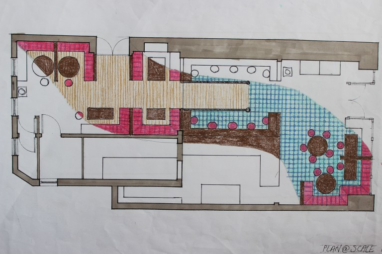 Design Concept 2 Plan View with wooden floored booth seating area towards the back of the cafe, counter seating area around the ramp up to the back area and some booth and table seating areas towards the front of the cafe. The front of the cafe would have blue Moroccan style tiled floor and large rectangular serving area to the side of the kitchen.